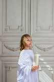 Beautiful little angel with candle praying Stock Photo