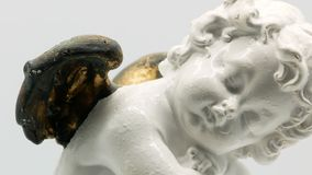 Beautiful little angel statuette on a white background 4k stock video footage