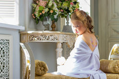 Beautiful little angel with wings sitting and thinking Stock Photography