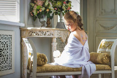 Beautiful little angel with wings sitting and thinking Royalty Free Stock Photography