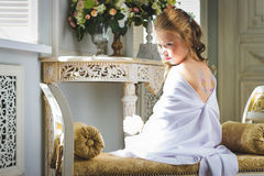 Beautiful little angel with wings sitting and thinking Stock Photo