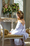 Beautiful little angel with wings sitting and thinking Royalty Free Stock Photo