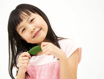 Beautiful asian girl with a leaf Stock Photo