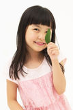 Beautiful asian girl with a leaf Royalty Free Stock Photography
