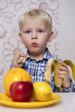 Beautiful Little Baby Boy Eats Banana Stock Photography