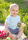 Beautiful little baby boy eats banana Stock Images