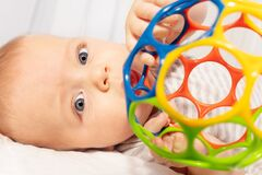 Free Beautiful Little Baby Boy Play With Colorful Ball Stock Image - 169805781