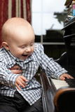 Beautiful little baby boy plays piano Royalty Free Stock Photos