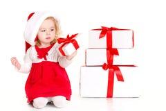 Beautiful little baby celebrates Christmas. Royalty Free Stock Images