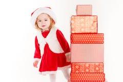 Beautiful little baby celebrates Christmas. Royalty Free Stock Photography
