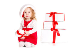 Beautiful little baby celebrates Christmas. Royalty Free Stock Photo
