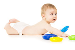 Beautiful a little baby crawling and playing with toys Stock Images