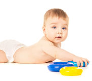 Beautiful a little baby crawling and playing with toys Royalty Free Stock Images