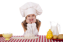 Beautiful little baby dressed as a cook Stock Photos