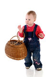 Beautiful little baby girl with a basket Stock Photography