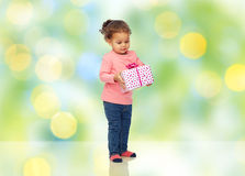 Beautiful little baby girl with birthday present Royalty Free Stock Photography