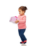 Beautiful little baby girl with birthday present Royalty Free Stock Photo