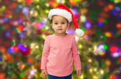 Beautiful little baby girl in christmas santa hat Stock Photography