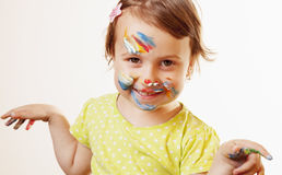 Beautiful  little baby girl doing make up humorous picture Royalty Free Stock Photography