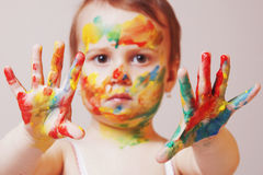 Beautiful little baby girl doing make up humorous picture