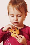 Beautiful little baby girl eating Chocolate Chip Cookie Royalty Free Stock Photography