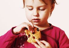 Beautiful little baby girl eating Chocolate Chip Cookie Food, t. Asty, sweets Stock Photo