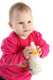 Beautiful little baby girl in a pink jacket Stock Photo