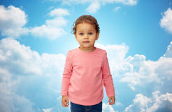 Beautiful little baby girl portrait over blue sky Royalty Free Stock Photos