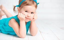 Beautiful little baby girl in a turquoise dress Stock Photo