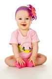 Beautiful little baby smiling with a flower Royalty Free Stock Photography