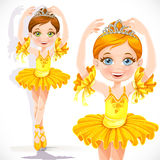Beautiful little ballerina girl in yellow dress and tiara Royalty Free Stock Image