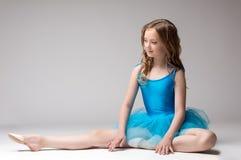 Beautiful little ballerina posing doing stretching Royalty Free Stock Photos