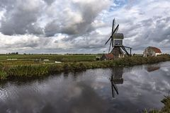 Traditional Dutch windmill with its barn royalty free stock photos