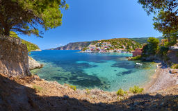 Beautiful little beach in Assos village, Kefalonia. Beautiful little beach with crystal water in Assos village in Kefalonia island, Greece Royalty Free Stock Images