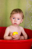 Beautiful little blond girl sitting in a bath Royalty Free Stock Photography