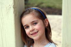 Beautiful little blond girl smiling Stock Photography