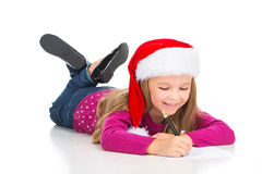Beautiful little blond girl writing letter to Santa Claus. Stock Images