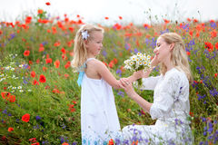 Beautiful little blonde girl and her mother, has happy fun cheer Stock Photography