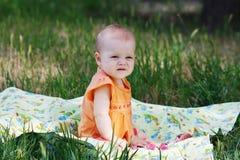 Beautiful little blonde girl in orange dress Royalty Free Stock Images