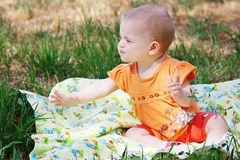 Beautiful little blonde girl in orange dress Royalty Free Stock Photography