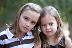 Beautiful little blonde girls outdoors royalty free stock image