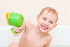 The beautiful little boy bathes in a blue bath Royalty Free Stock Photo