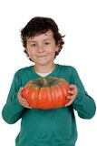 Beautiful little boy with a big pumpkin Stock Photos