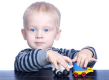 Beautiful little boy with blond hair and blue eyes Royalty Free Stock Images