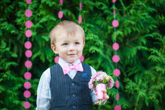 Beautiful little boy with a bouquet of flowers Royalty Free Stock Images