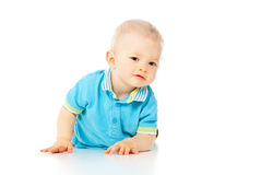 Beautiful little boy crawling on the floor Royalty Free Stock Photos