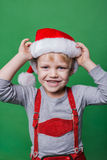 Beautiful little boy dressed like Santa Claus helper. Christmas concept Royalty Free Stock Image