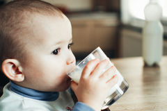 Beautiful little boy drinking milk Stock Photo
