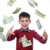 Beautiful little boy and flying dollar bills isolated Stock Images