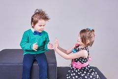 Beautiful little boy and girl clap their hands and smile. For any purpose Royalty Free Stock Photography